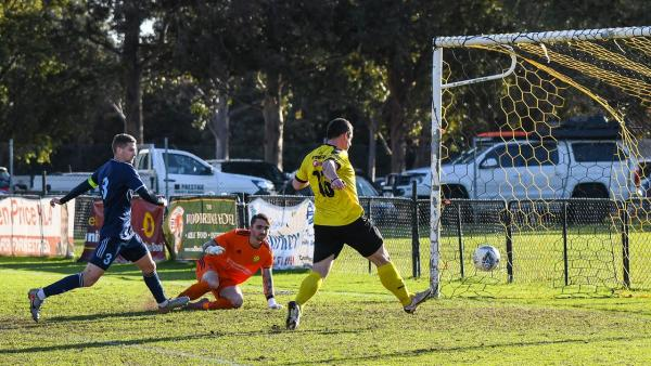Dan Corbett scores for Forrestfield against Joondalup United. Photo by Cat Bryant